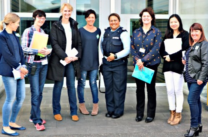 Stacey Shortall and other Mothers Project volunteer lawyers standing with Dairy-Fau Tanuvasa, PCO at Auckland region Women's Corrections Facility